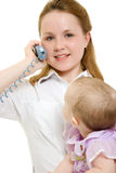 Businesswoman with a baby on the phone Stock Image