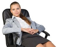Businesswoman back in office chair, with hands Stock Images