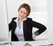 Businesswoman with back pain Stock Photography