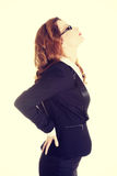 Businesswoman with back pain. Stock Photography
