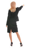 Businesswoman a back and shows aside a hand Stock Photo