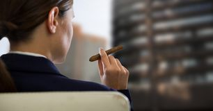 Businesswoman Back Sitting in Chair with  cigar and  buildings Royalty Free Stock Images