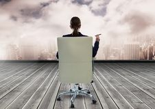 Businesswoman Back Sitting in Chair with cigar and city sky Stock Photo