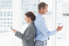 Businesswoman back-to-back with colleague Stock Photo