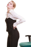 Businesswoman with backache back pain isolated Royalty Free Stock Photos