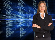 Businesswoman with background of digital code Stock Photography