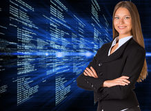 Businesswoman with background of digital code Stock Photo
