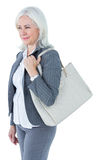 Businesswoman with bag Stock Photos