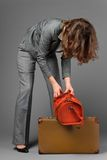A businesswoman with a bag and a suitcase. Stock Photo