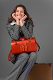 A businesswoman with a bag and a suitcase. Stock Photography