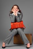 A businesswoman with a bag and a suitcase. Stock Photos