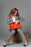 A businesswoman with a bag and a suitcase. royalty free stock photos