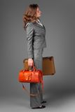 A businesswoman with a bag and a suitcase. Royalty Free Stock Image