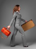A businesswoman with a bag and a suitcase. Royalty Free Stock Images