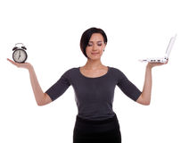 Businesswoman balance with clock and laptop Royalty Free Stock Photography