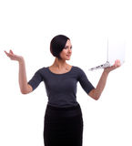 Businesswoman balance with laptop Royalty Free Stock Photography