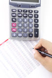 Businesswoman balancing the accounts. On white background Stock Images