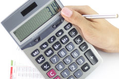 Businesswoman balancing the accounts. With calculator and pen Royalty Free Stock Images