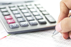 Businesswoman balancing the accounts. With calculator and pen Stock Images