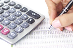 Businesswoman balancing the accounts. With calculator and pen Stock Photography