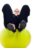 Businesswoman balancing on exercise ball Royalty Free Stock Images
