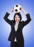 Businesswoman with ball on white Stock Photography