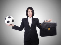 Businesswoman with ball on white Stock Images