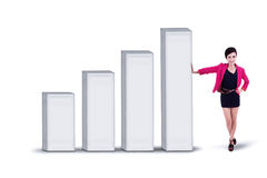 Businesswoman and bar chart - isolated Stock Photo