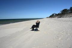 Businesswoman on beach stock photos