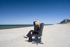 Businesswoman on the beach royalty free stock photography