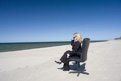 Businesswoman on beach Stock Photos