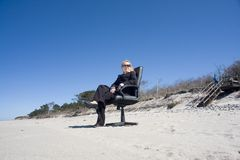 Businesswoman on beach Royalty Free Stock Images