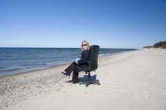 Businesswoman on beach Royalty Free Stock Photography