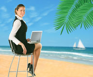 Businesswoman on the beach. Stock Images