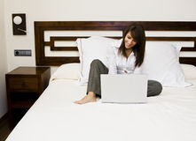Businesswoman in bed Stock Photography