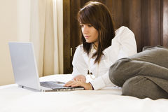 Businesswoman in bed Royalty Free Stock Photos