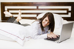 Businesswoman in bed Stock Image