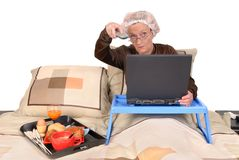 Businesswoman in bed, working Stock Images