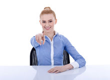 Businesswoman behind the desk pointing at you Royalty Free Stock Photography