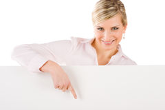 Businesswoman behind empty banner point down Royalty Free Stock Image