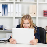 Businesswoman Behind Laptop At Office Desk Royalty Free Stock Photos