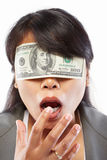 Businesswoman being blinded with money stock photography
