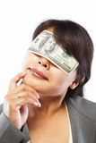 Businesswoman being blinded with money Royalty Free Stock Images