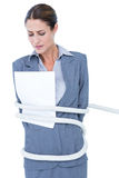 Businesswoman being tied up Stock Photography