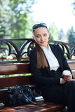 Businesswoman on bench Royalty Free Stock Images