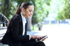 Businesswoman on bench Stock Image