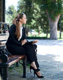 Businesswoman on bench Royalty Free Stock Image