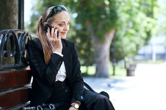 Businesswoman on bench Royalty Free Stock Photography