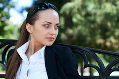 Businesswoman on bench Stock Photo