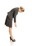 Businesswoman bending down Royalty Free Stock Photography